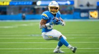 Pro Football Player Austin Ekeler and running back for the NFL Los Angeles Chargers running with a football