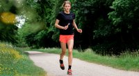 Triathlete Beth Potter running on a path and training for a triathlon using her running tips