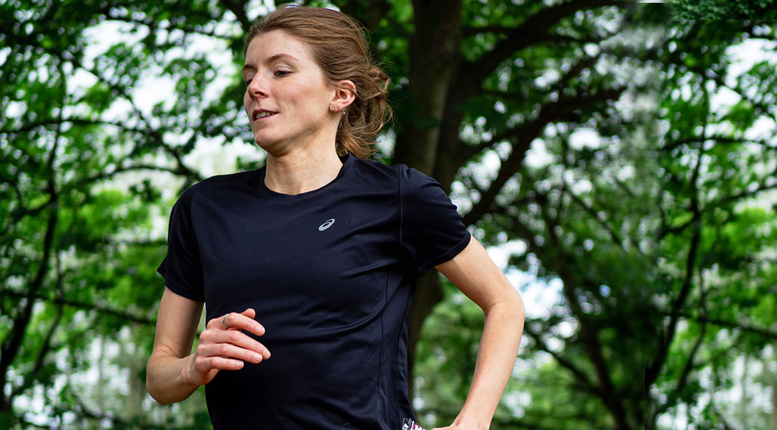 Triathlete Beth Potter running using her running tips to train for a thriathlon in the woods