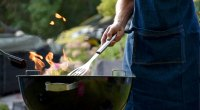 Man Barbecuing Healthy 4th of July Recipes On A Grill