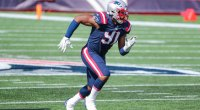 The New England Patriots defensive end Deatrich Wise running on a football field