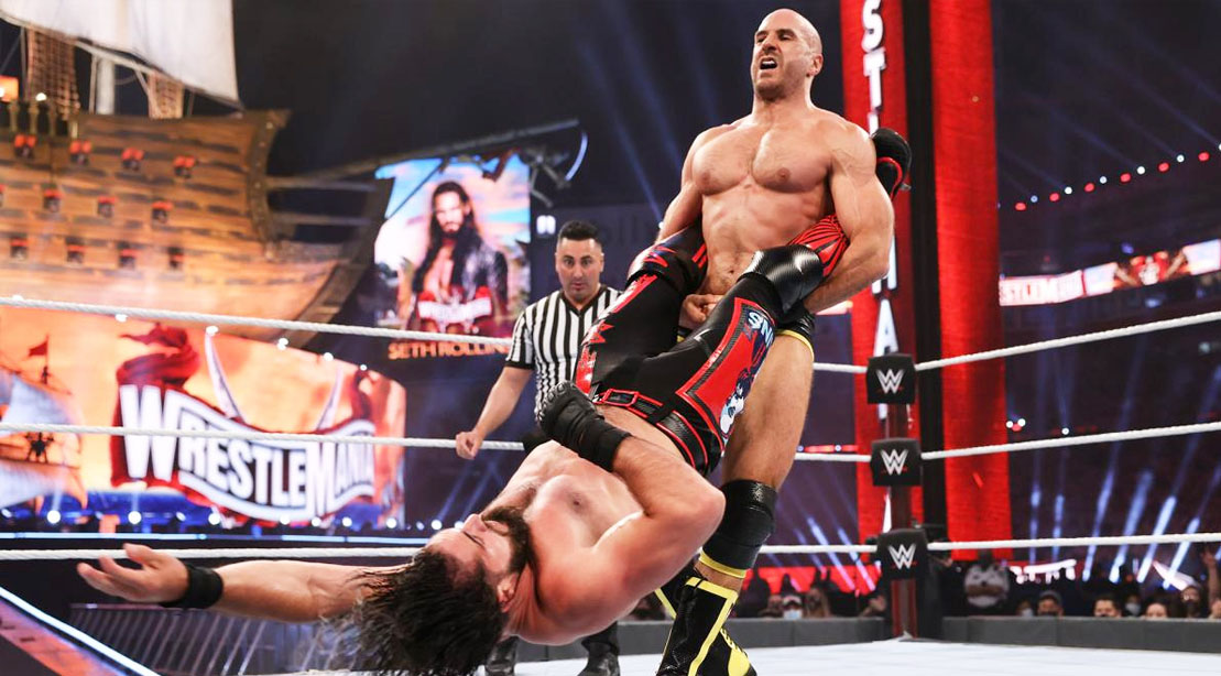 WWE wrestler 'Swiss Cyborg' Cesaro performing a pro-wrestling move on WWE wrestler Roman Reigns
