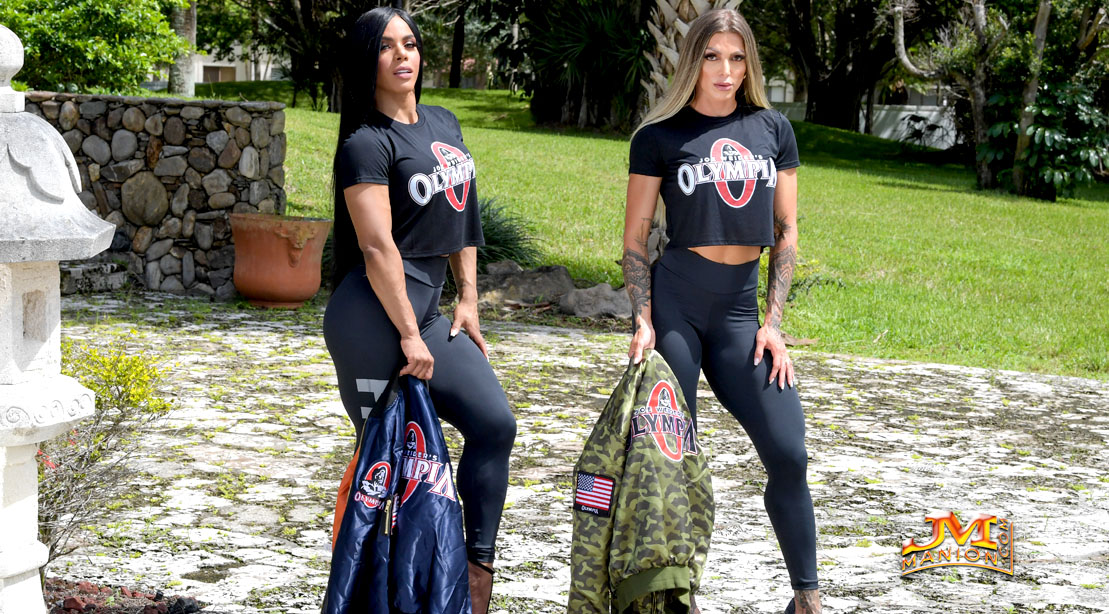 Female bodybuilding models holding Olympia Bomber jackets from Olympia Apparel