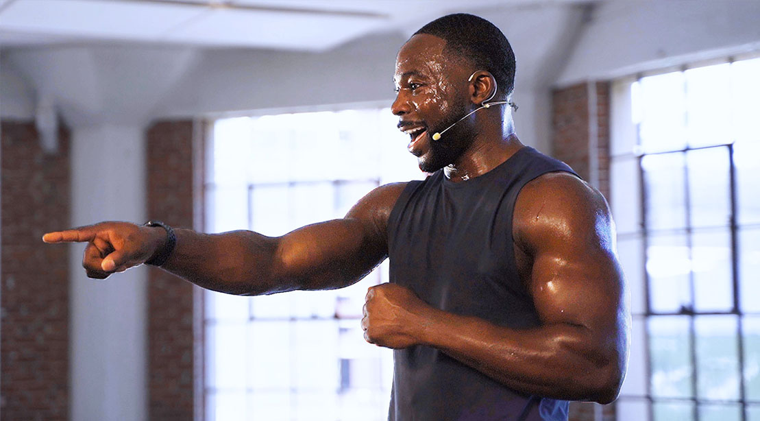 Gideon Akande working out with a On Demand Total Body Strength Circuit Workout