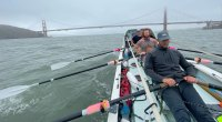 Jason Caldwell and his rowing team rowing in the San Francisco Bay in front of the Golden Gate Bridge for The Great Pacific Race