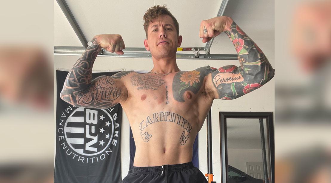 """Logan Carpenter flexing his muscles for his """"Chest Destruction"""" Workout"""