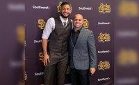 Major League Baseball agent Roger Tomas standing with San Diego Fernando Tatis