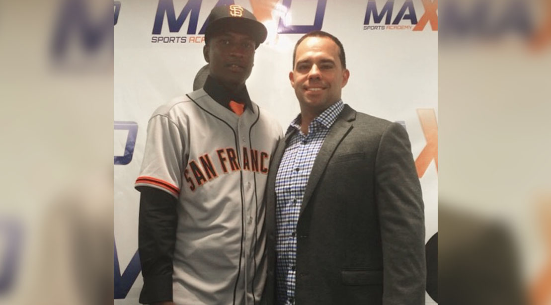 Major League Baseball agent Roger Tomas standing with San Francisco Giant Lucius Fox