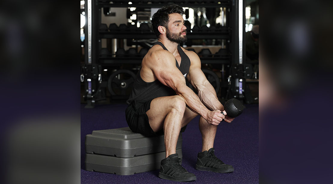 Man performing Wenning Wrist Flicks exercise for his arm workout