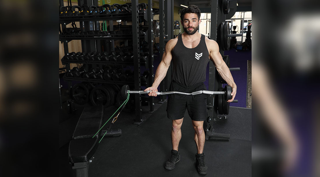 Man performing a Harski Hammer Curl arm exercise for his arms workout