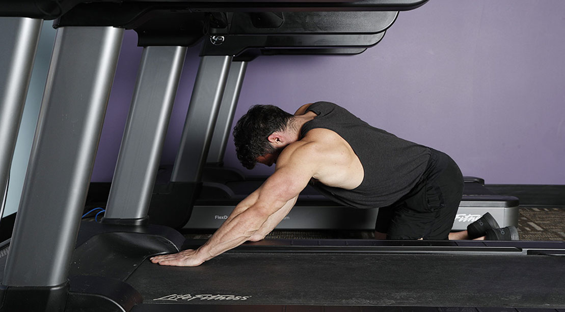Man performing the treadmill press exercise for his arm workout