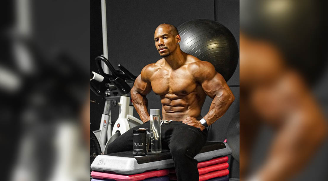 Roger Snipes using pre-workout while sitting on a bench