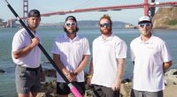Rowmates Jason Caldwell, Angus Collins, Jordan Shuttleworth, Duncan Roy preparing for the Great Pacific Race holding a rowing paddle in front of the Golden Gate Bridge in San Francisco