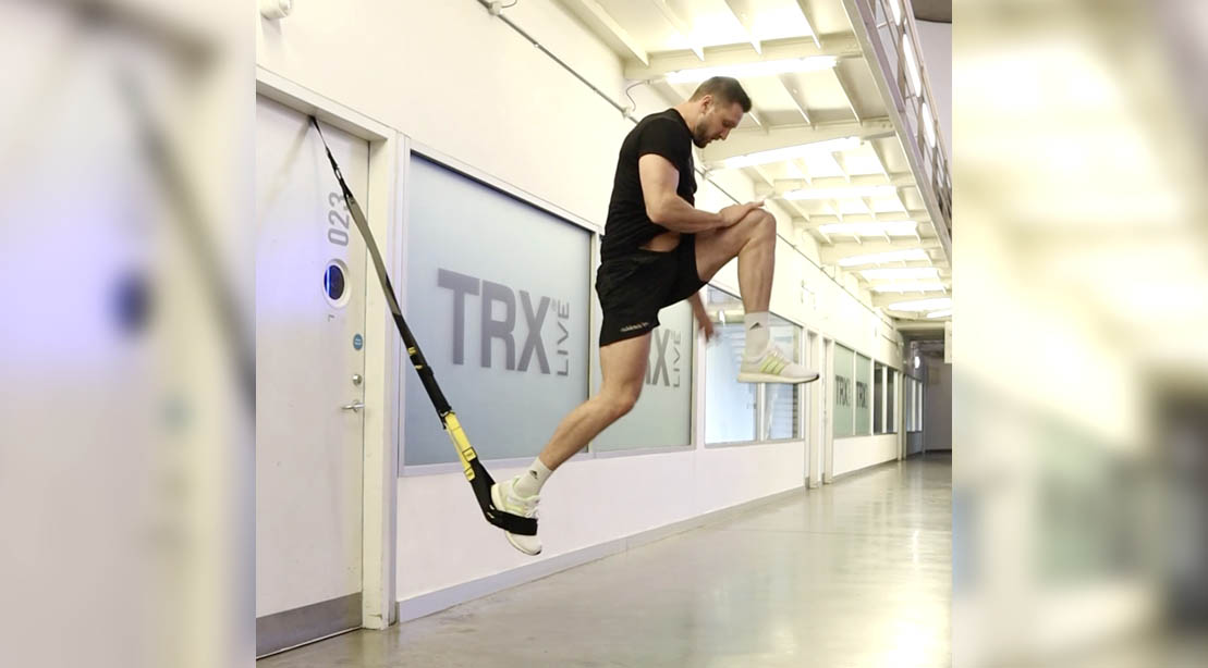 TRX suspension trainer Jay Brockway performing a One-Legged Power Burpee