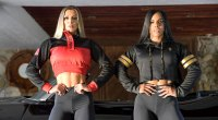 Two female bodybuilders modeling for Olympia Apparel bomber jackets