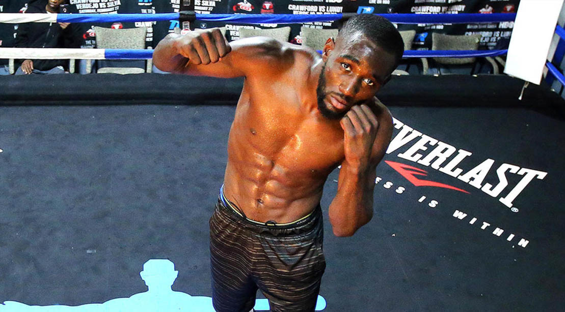 Boxing Champ Terrance Crawford throwing a punch in a boxing ring