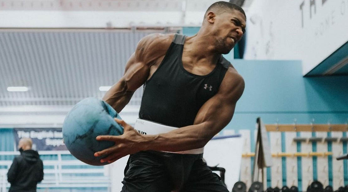 British boxing champ Anthony Joshua workout with a medicine ball slam against the wall