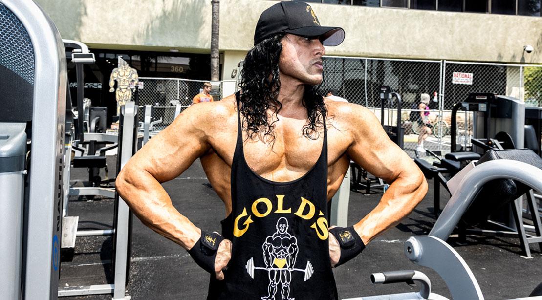 Darius Dar-Khan wearing a black Gold's Gym muscle shirt
