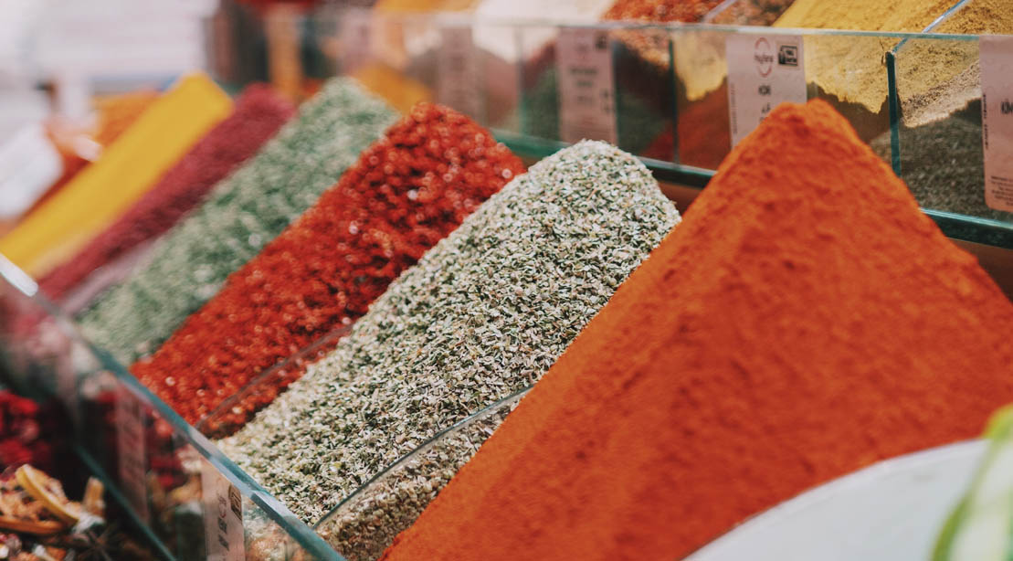 Different colored spices on display at a market