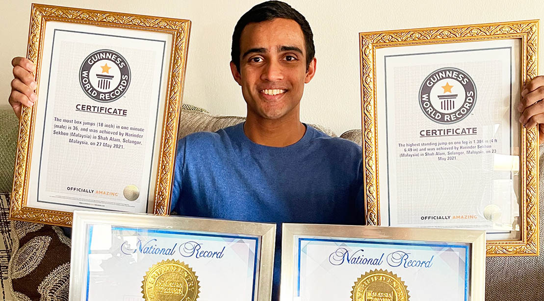 Harinder Sekhon holding his Guinness world record titles for jumping