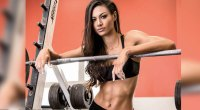 Janet Layug wearing a bikini bra and posing behind a bench after working out