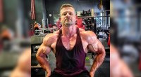 Jason Parrish showing his muscular arms and shoulders while sitting on a bench in the gym