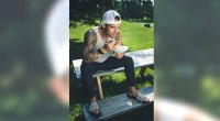 Michael Chernow eating oatmeal on a park bench
