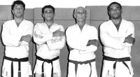 BJJ Legendary family the Gracie Family and Rickson Gracie posing in their jiu jitsu gi