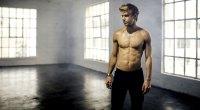 Josh Kramer in his yoga studio perparing to do yoga poses