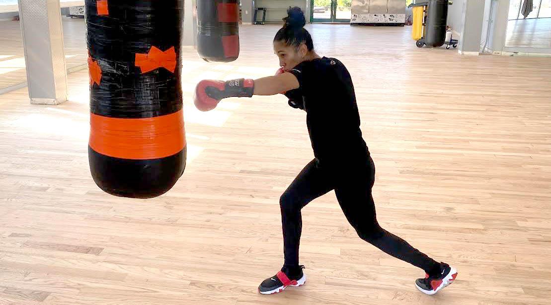 Women's Featherweight Champion Amanda Serrano training and hitting a heavy bag